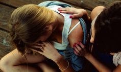young-woman-comforts-her-pregnanct-friend