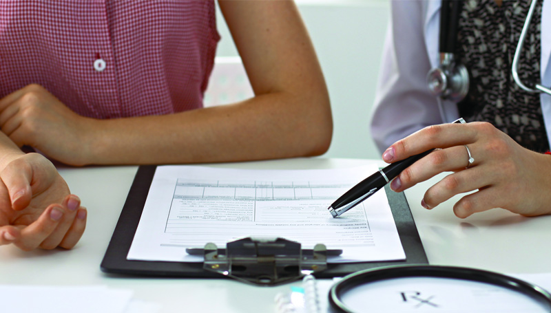 doctor reviewing sti test results with young woman