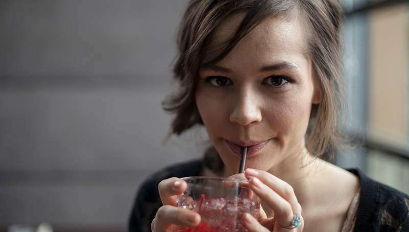 young woman drinking a cocktail