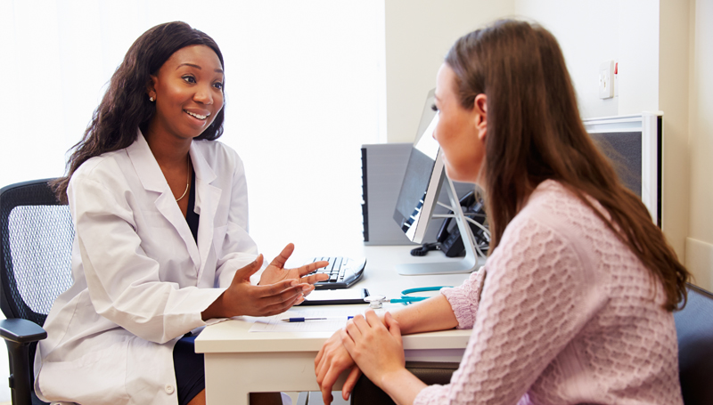 young woman getting medical advice from a doctor
