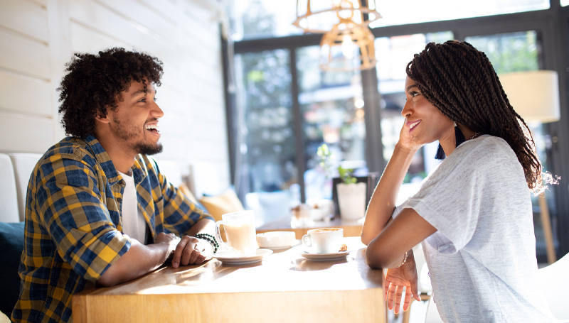 young couple on a date at a coffee shop