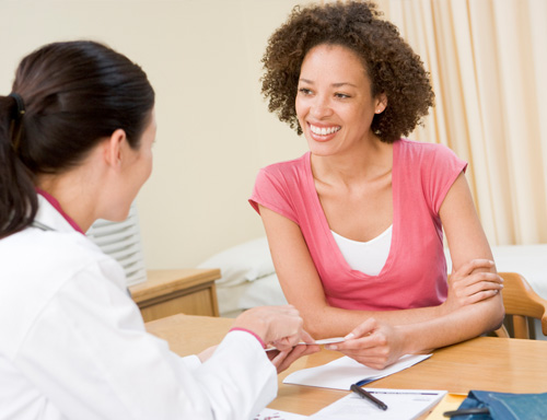 woman talking with referred doctor