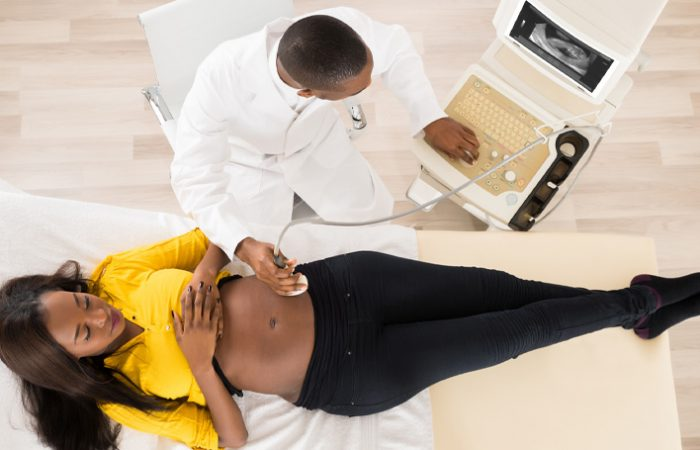 healthcare worker performing an obstetrical ultrasound