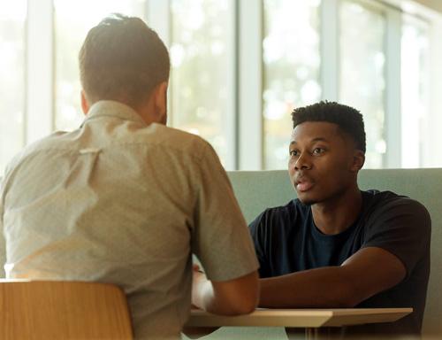 men talking and listening