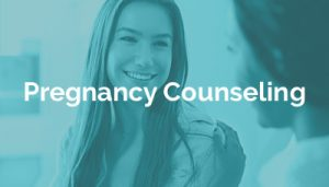 young woman receiving pregnancy options counseling
